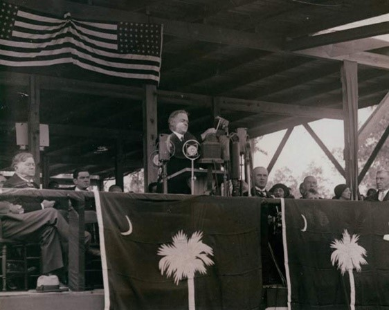 Picture of President Hoover standing on the speakers' stand to deliver his speech.
