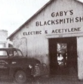 This is the original image of Gaby's Blacksmith Shop in business.