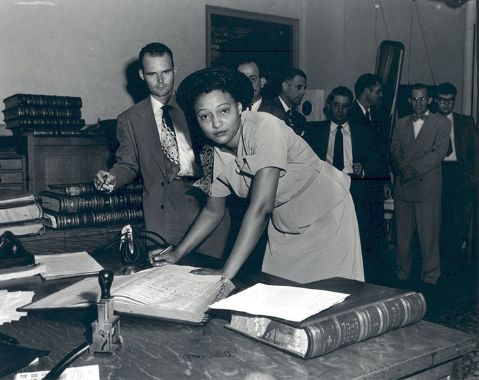Ada Lois SIpuel Fisher is pictured here in 1952 signing the register of attorneys.