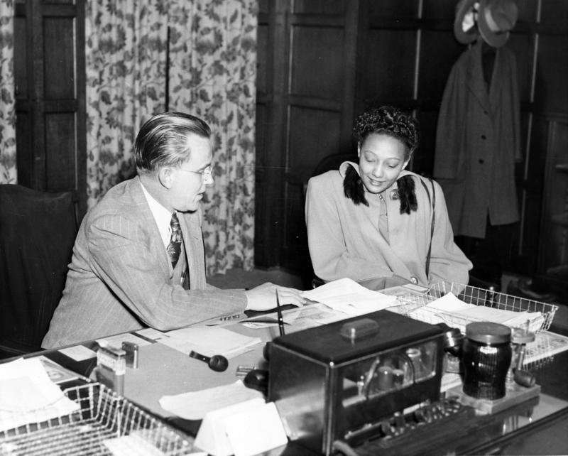 Former University of Oklahoma President George Lynn Cross in discussion with Ada Lois SIpuel Fisher.