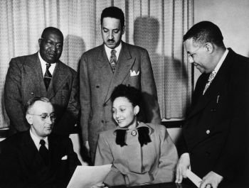 Ada Lois SIpuel Fisher presents her admission application to the University of Oklahoma. Pictured with her is Thurgood Marshall, renowned civil rights activist and lawyer.