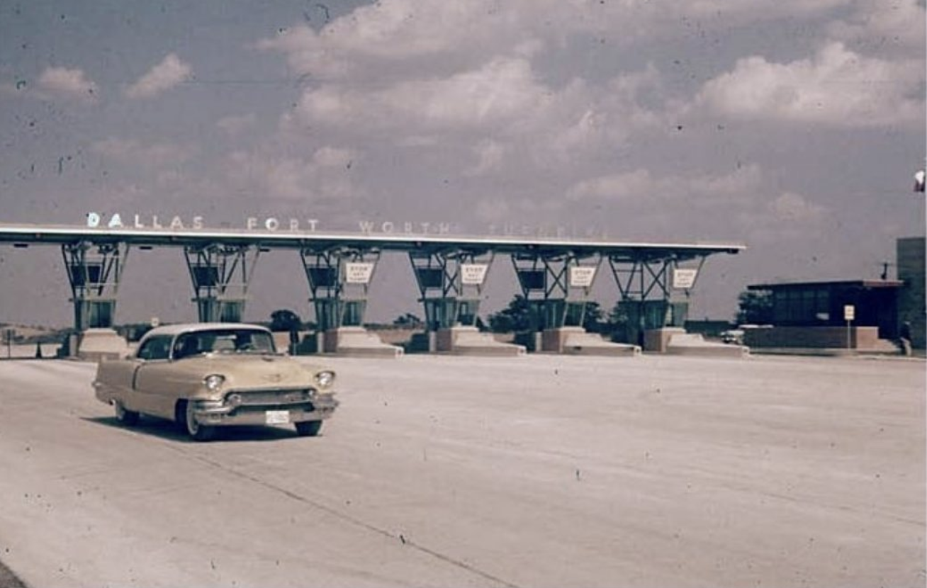 This is an older image of the Dallas-Fort Worth Turnpike, and a tollbooth.