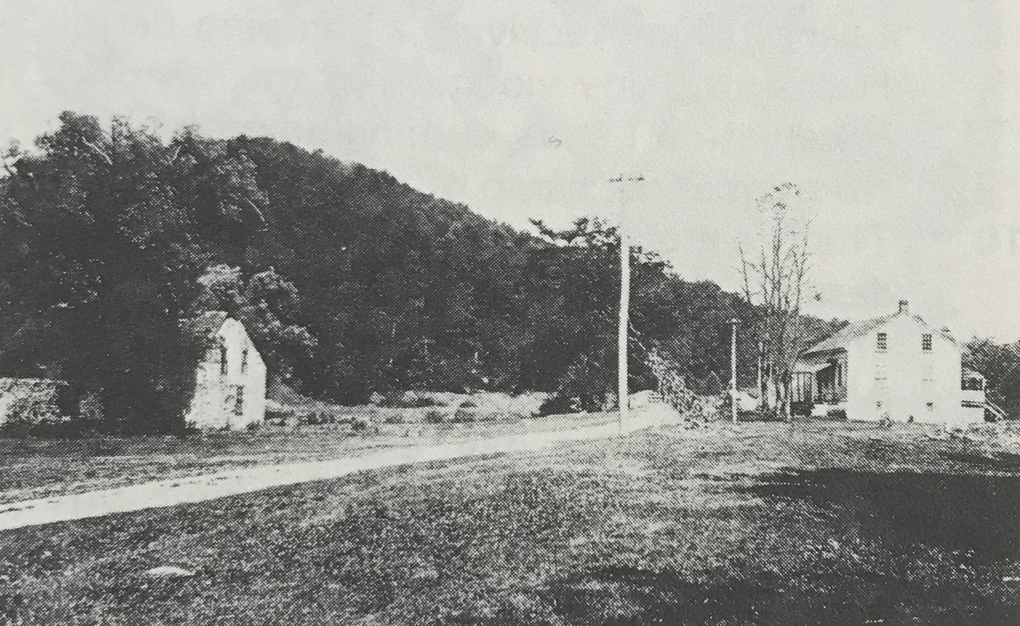 Taken in 1903, this photo shows the forested area of the state park along with the road that is still used today, the Lincoln Highway. Thaddeus Stevens' Blacksmith Shop is on the left, while the office of the iron furnace is on the right.