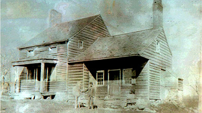 A very early photograph of the house ca. 1880. Notice the absence of the enclosed porch, added later in the 20th century.