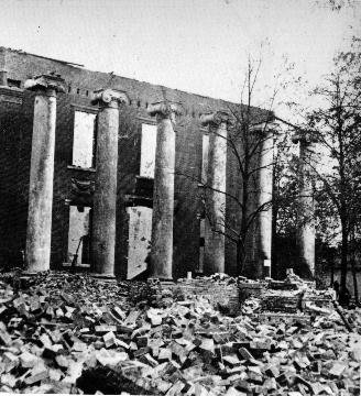 Photograph of courthouse after its destruction by Confederate raiders. The Greek Revival columns were preserved as part of the new courthouse built in 1865. Courtesy of Wikipedia.