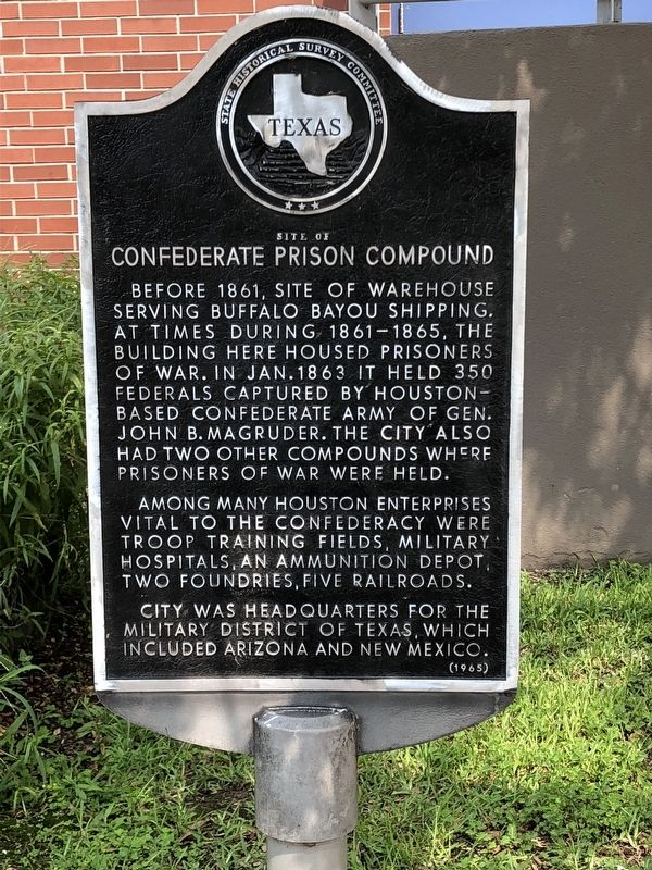 The historical marker is situated in a sitting area outside of the Student Life Center on the University of Houston-Downtown campus