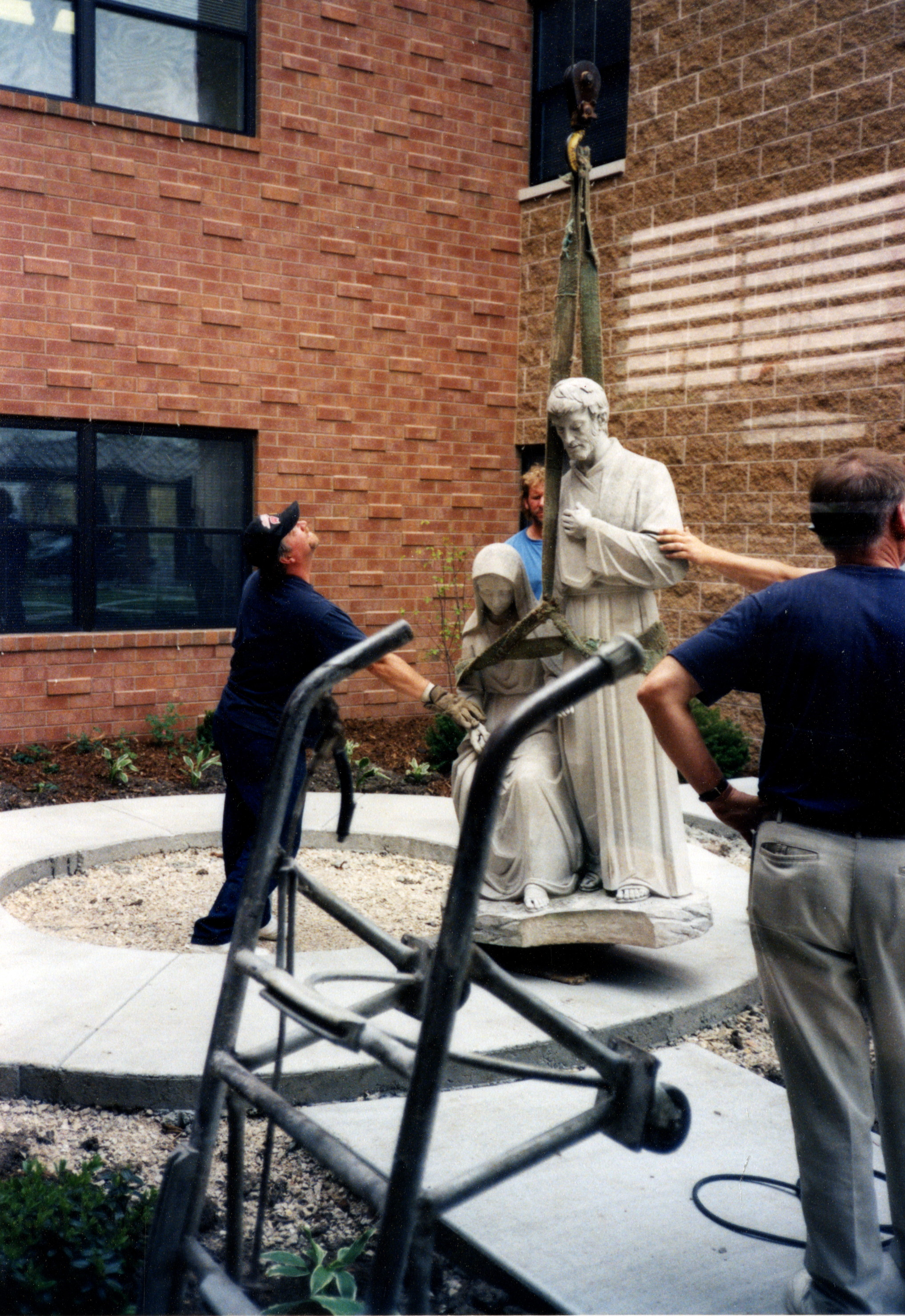 Workers install statuary at Nazareth Court and Center, 1998.