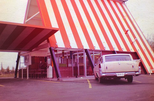 The first Whataburger ever with A-Frame architecture, and white and orange striped roof.