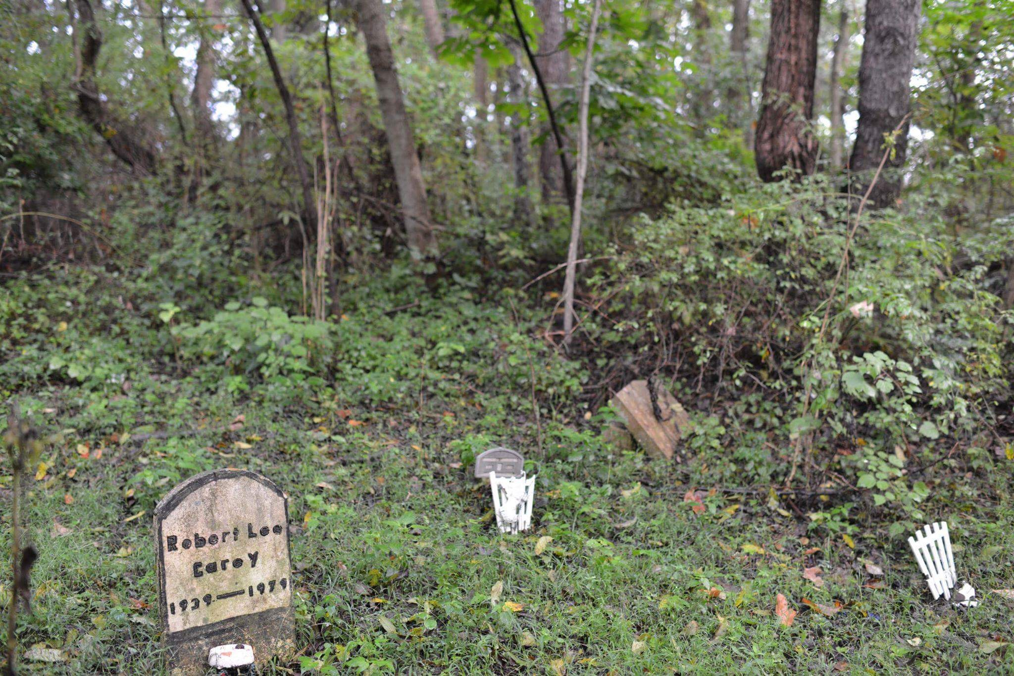 Many of the grave markers are in wooded areas like this one