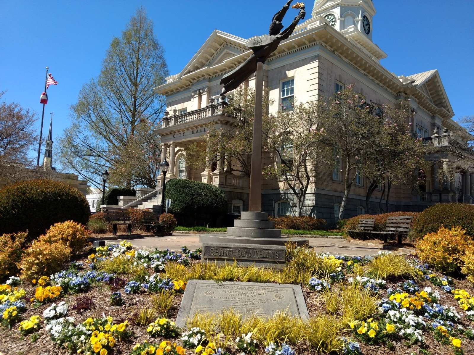 """Torchlighter"" stands right outside of City Hall. The inscription on the base of the statue is  from Ephesians 4:3, which reads, ""Endeavouring to keep the unity of the Spirit in the bond of peace."" The statue was donated by the Athens Rotary Club."