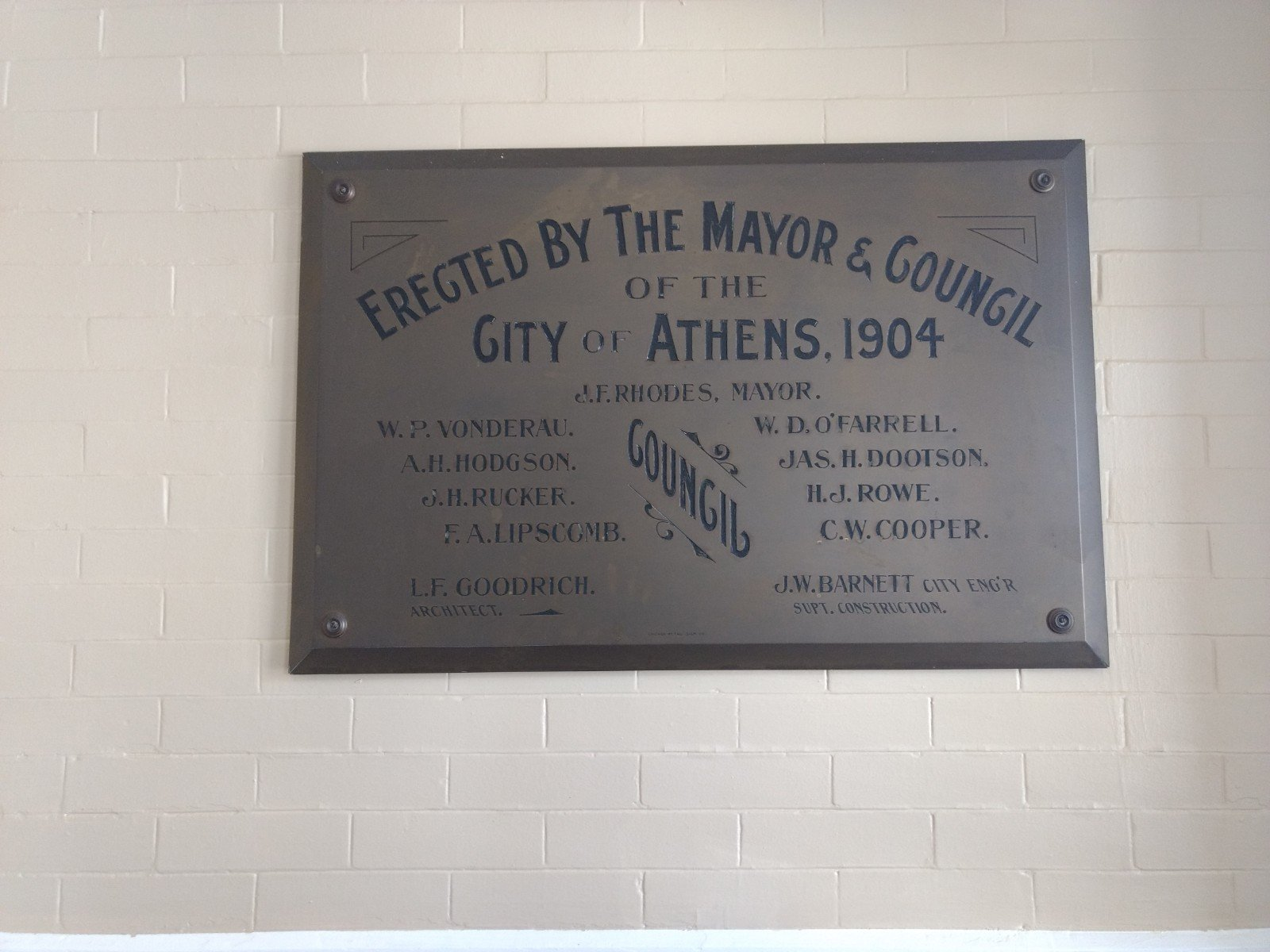 A plaque commemorating when construction on City Hall was completed