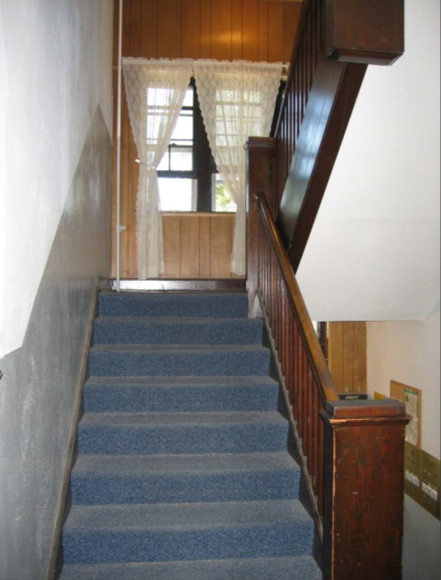 The stairs inside showing a view of the original woodwork.