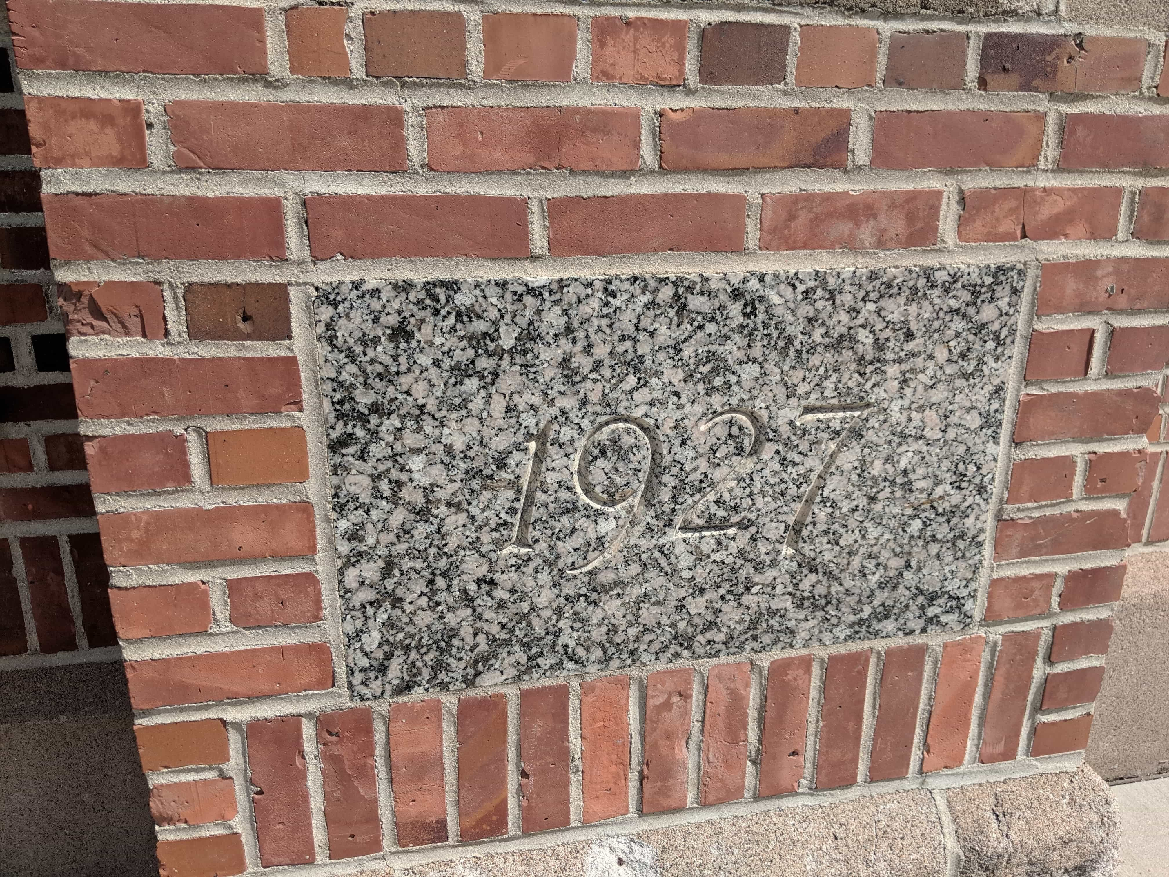 The cornerstone of the stadium dated 1927. The cornerstone is located on the north-western side of the building.