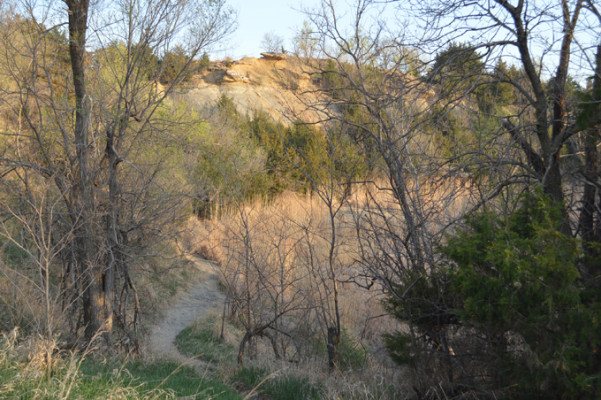 This is a view of the park from the west looking up at Indian Rock hill. There is a splendid view of Salina and the Smoky Hill River from the top of the hill. The small pond, which provided sand, gravel, and clay for brick making is in the foreground