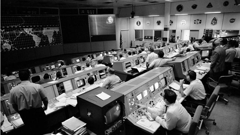 This is an image of an Apollo-era mission control room that used updated technology from the Gemini mission control room. One of the largest upgrades came in the form of screens in every console allowing the controllers to monitor spacecraft changes