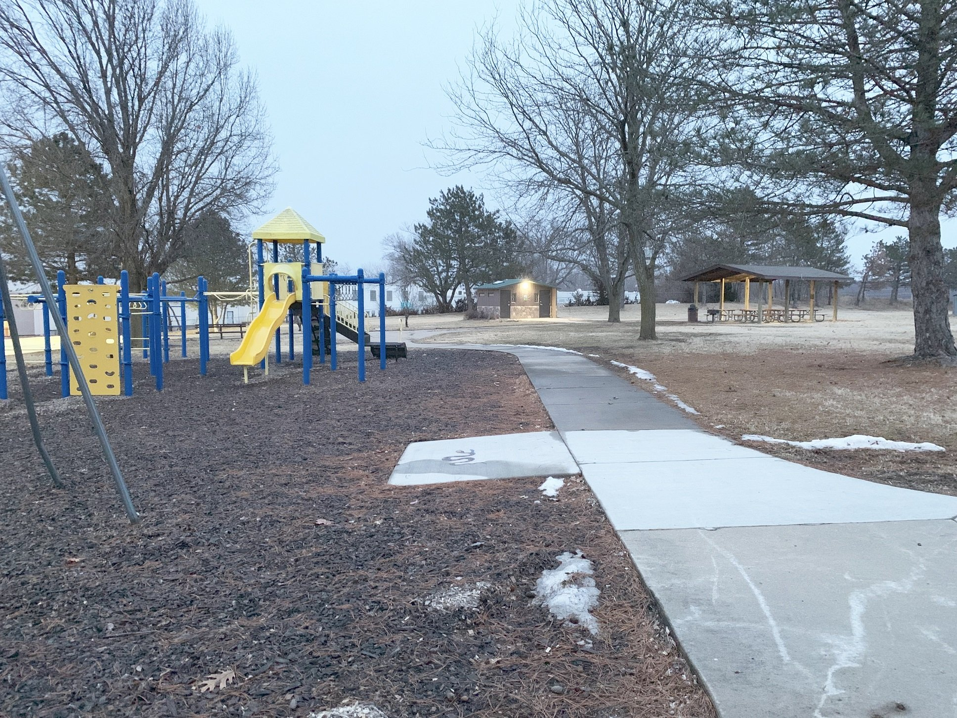 A different view of the park, including the playground and shelter.