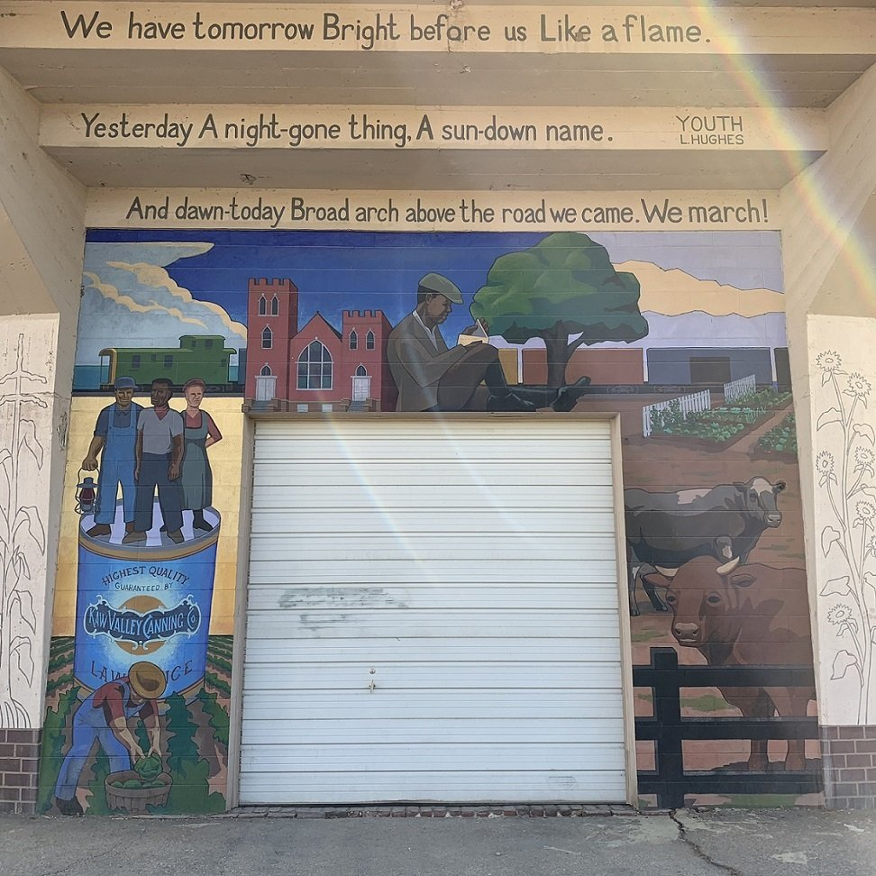 Panel of the mural with a quote from Langston Hughes's poem, Youth. A young Langston Hughes is also painted on top of the garage.