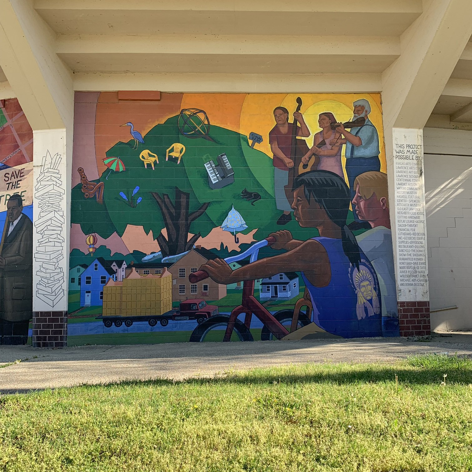 The final panel of the mural which describes a peaceful and diverse modern-day Lawrence.