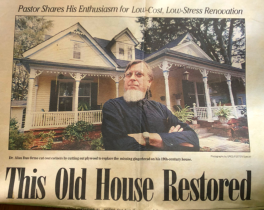 Dr. Orme posing with his house.