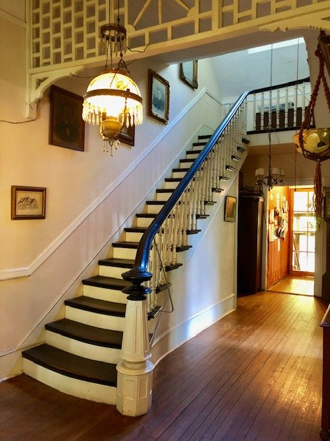 The grand staircase and central hallway added by the Cox family.