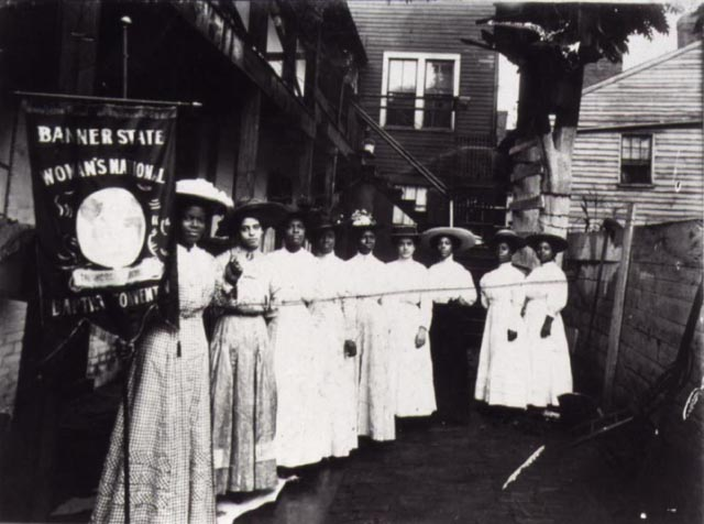 Nannie Helen Burroughs Holding a Woman's National Baptist Convention Banner, c. 1905-1915
