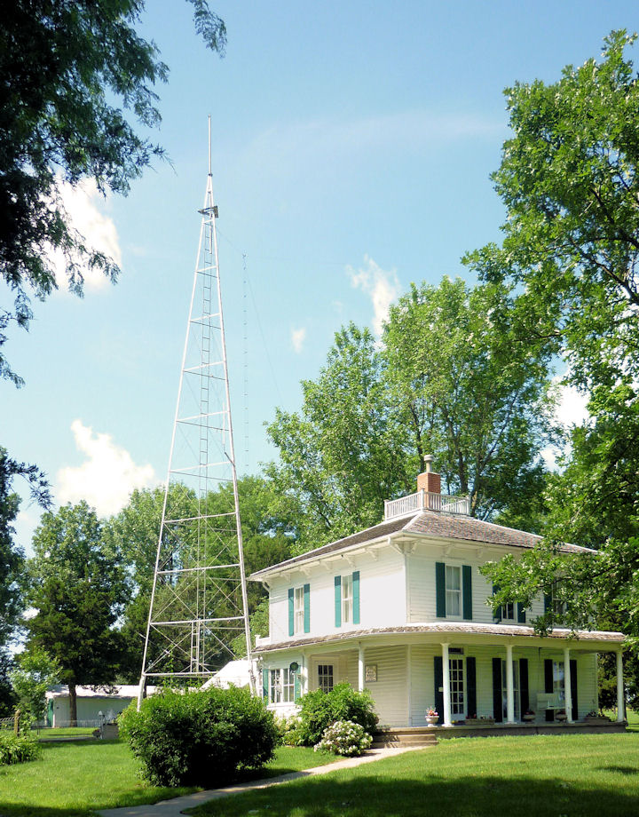 The Ensor Farmhouse with one of two radio towers