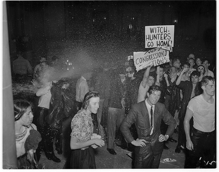 Soaked students protesting HUAC's presence in City Hall on May 13, 1960