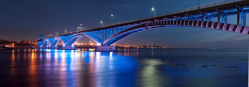 Photograph of the bridge at night from the Peace Bridge's official website