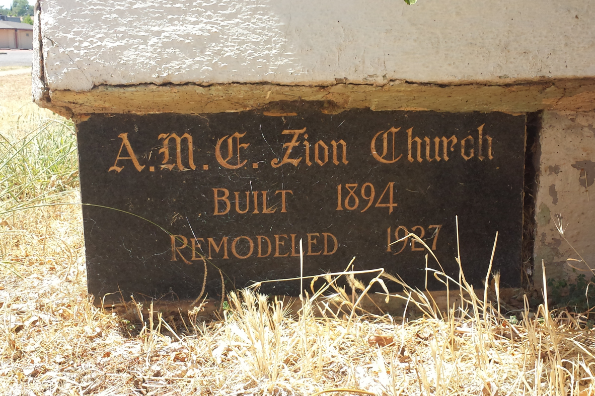 Bench outside of the original AME Zion Church in Redding.