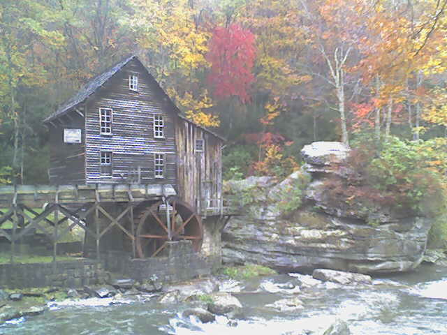 Picture of the mill from across the creek in the fall