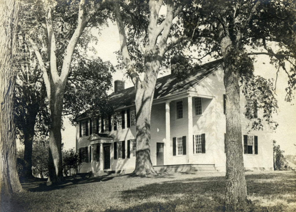 A photo of the homestead taken sometime around 1910.  Notice the large elm trees that are no longer on the property.