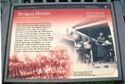 Photograph of the Shotgun Houses Historical Marker.
