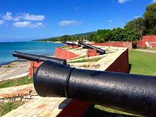 The fort includes replicas of cannon pointed towards the Caribbean Sea.