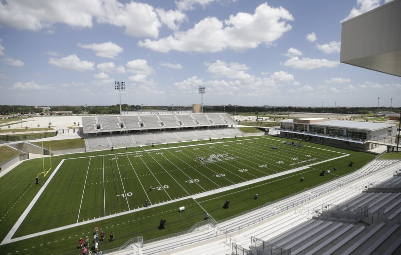 A view of Legacy Stadium's, Katy ISD's second football stadium, artificial turf and seating options. 