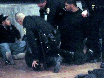 New Years Day 2009, Oscar Grant being aggressively pinned down by BART police officers, moments before he was fatally shot in the back.