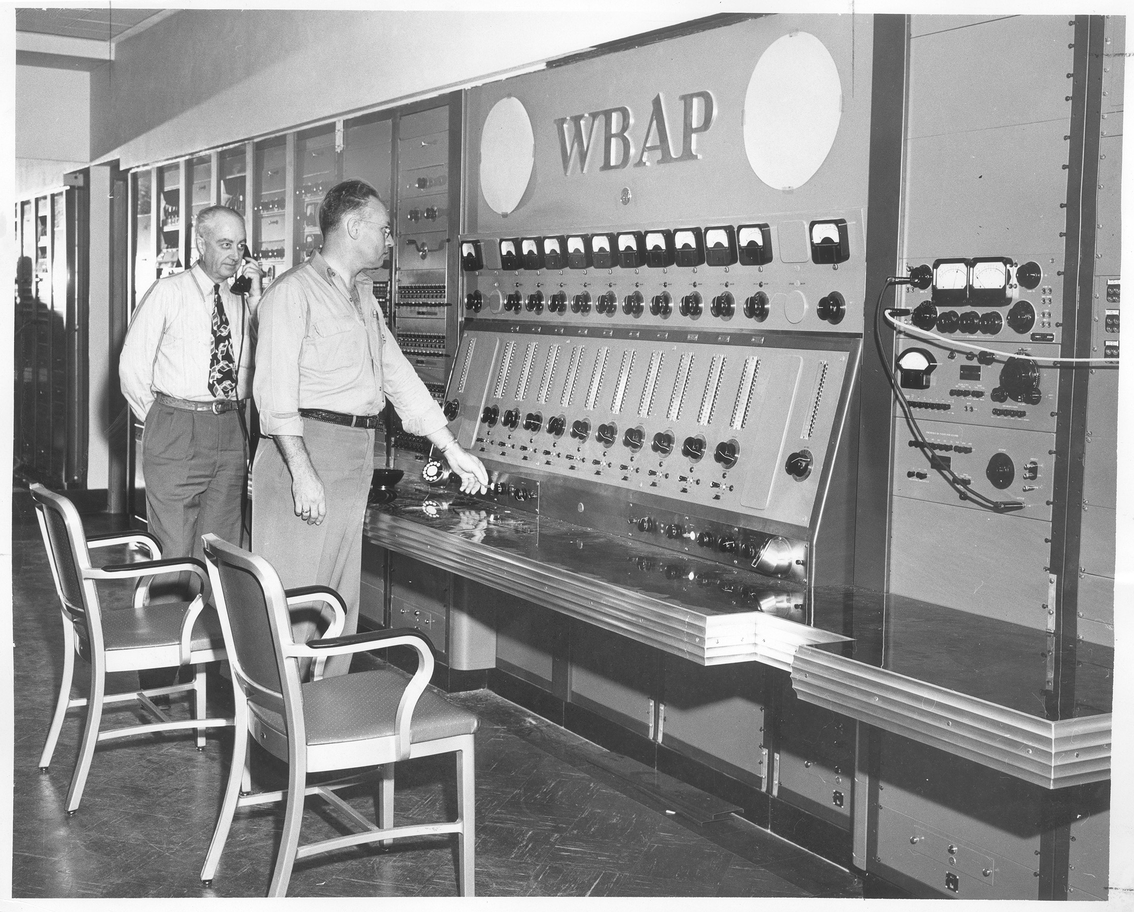 Roy Bond, assistant master control supervisor, and R.C. Stinson, director of engineering, starts first broadcast of WBAP-TV from new building at 3900 Barnett, 6 a.m., Sunday, 06/19/1949.
