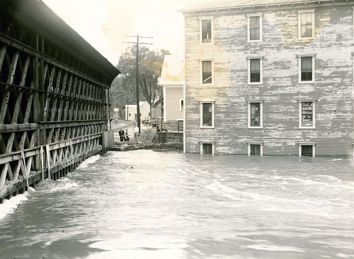 Image of the covered railroad bridge in Contoocook during high waters.