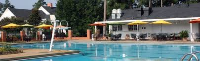The Club pool is located on a beautifully groomed one-acre lot, fenced for security.