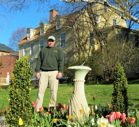 A volunteer with the Portsmouth Historical Society works on the house's garden.
