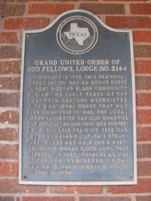 The marker is affixed to the east wall of the building along Grove Street.
