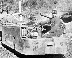 Miner on shuttle car (early 1900s)