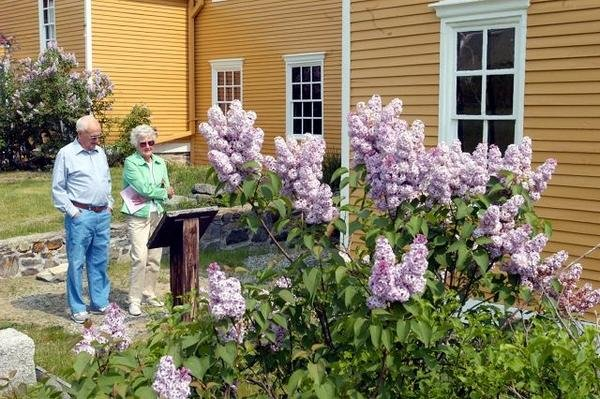 These visitors enjoy the mansion's annual Lilac Festival which occurs in late May.