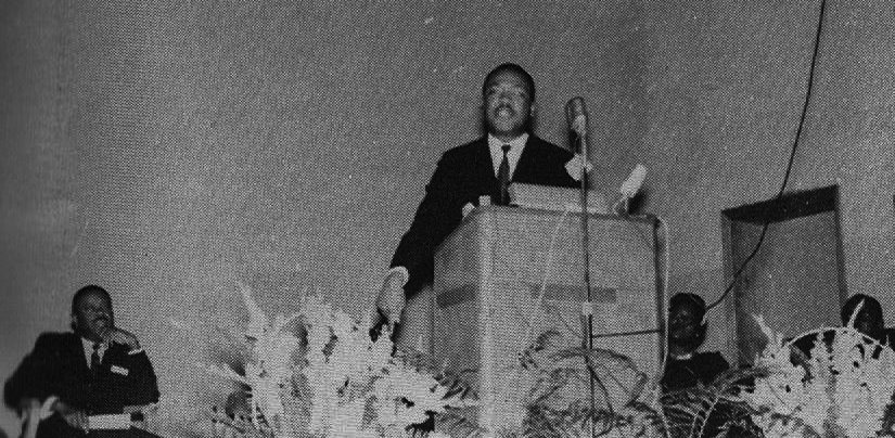 Dr. King speaking at Oakwood College during his visit to Huntsville. Seated on the left is Ralph David Abernathy