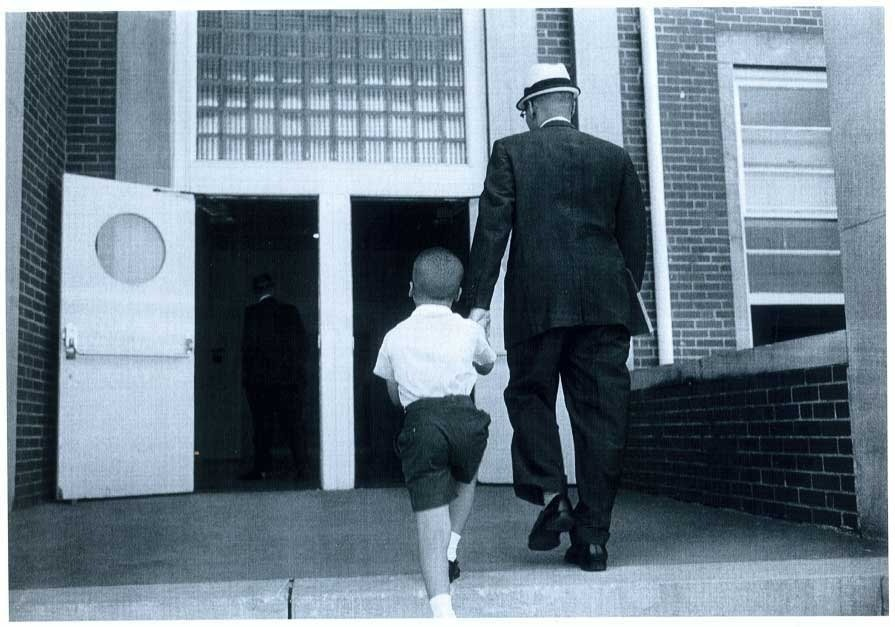 Dr. Sonnie W. Hereford III escorts his son Sonnie Hereford IV into Fifth Avenue School