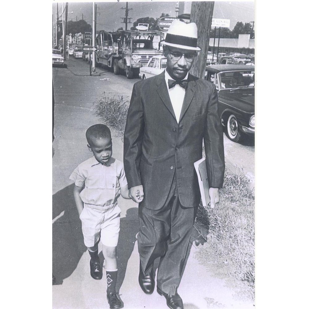 Dr. Sonnie W. Hereford III and his his son Sonnie Hereford IV return home after their first attempt to integrate Huntsville's Fifth Avenue School was blocked by Alabama State Troopers.