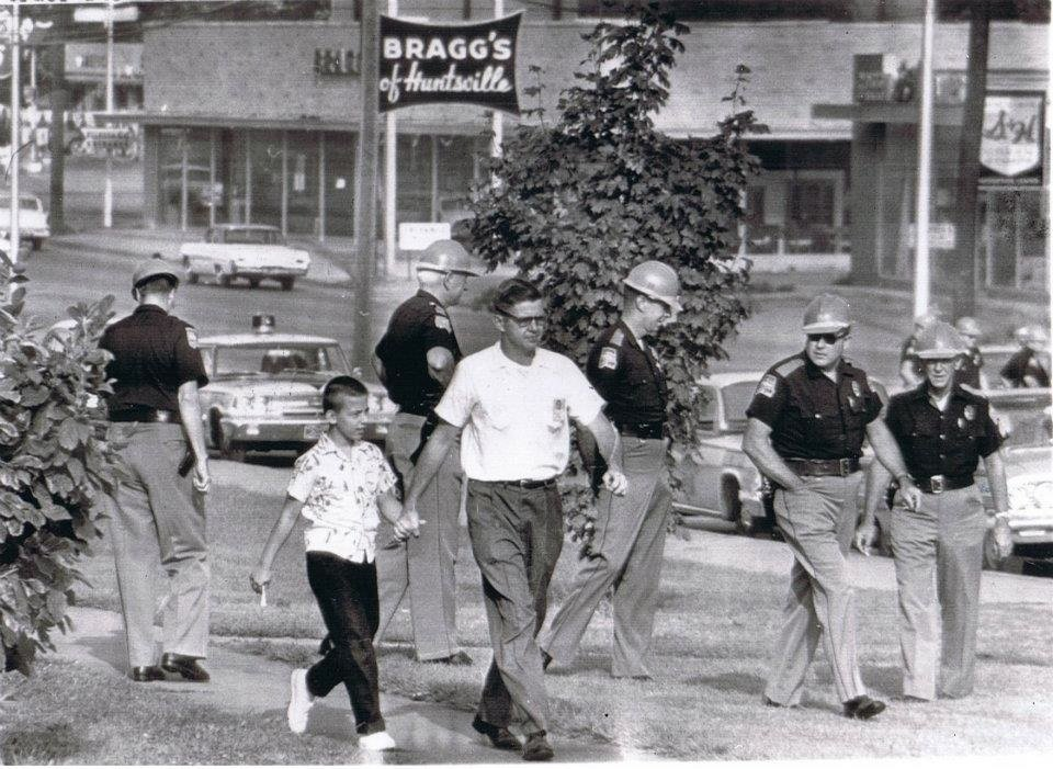 Alabama State Troopers fill the campus of Fifth Avenue School to prevent integration of the school. Note the Bragg's Furniture sign in the background, which still stands today on the north side of Governor's Drive.
