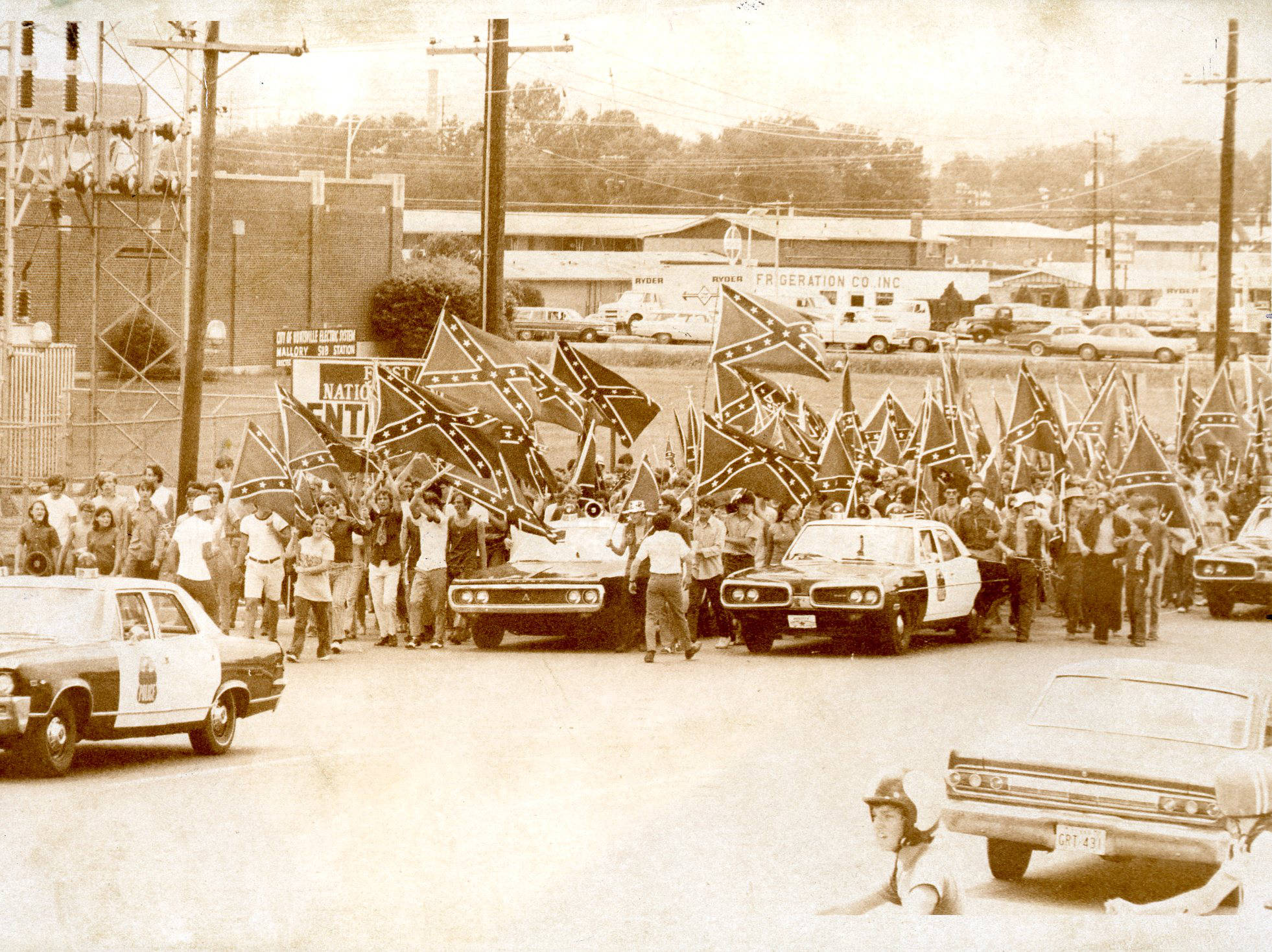 In 1971, Butler High students demonstrate in support of the use of the Confederate battle flag, after Judge Grooms ruled against the practice.