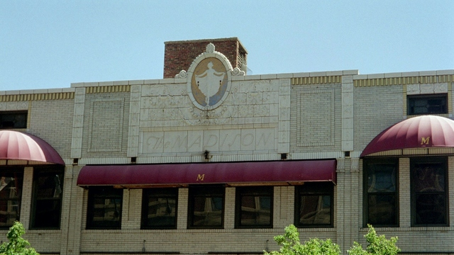 Madison Theater with name engraved in facade.