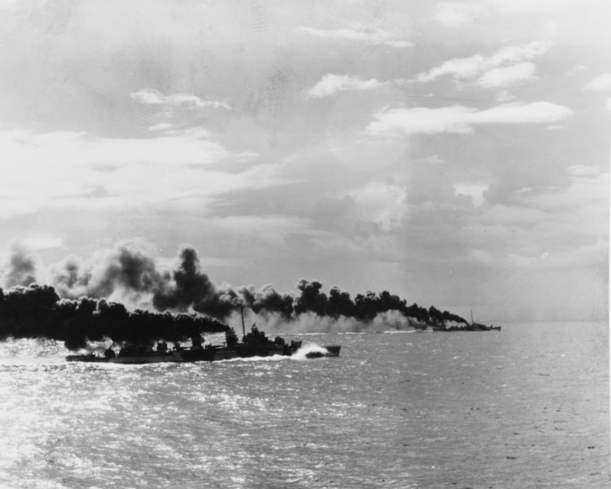 As seen from the White Plains, USS Heerman lays smoke to cover Taffy 3