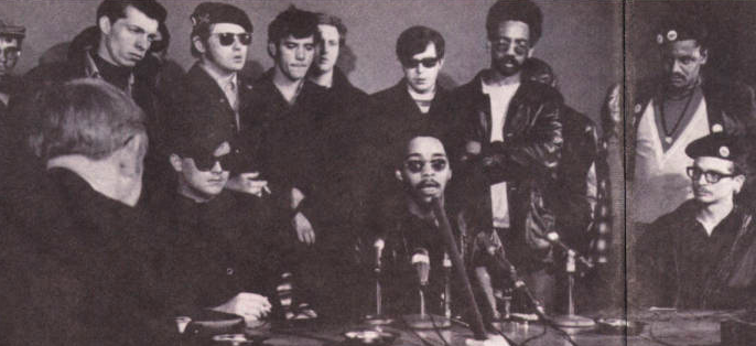 This photograph was taken at a joint press conference with the Young Lords and Black Panthers on the one year anniversary of Martin Luther King Jr.'s assassination. 